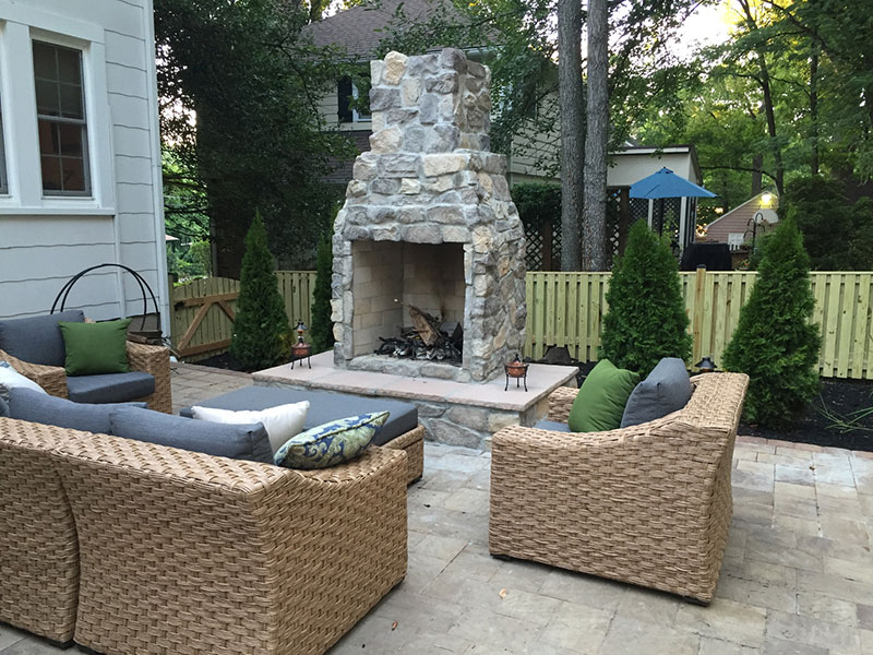 Backyard Fireplace, Hearth, Paver Patio, and Seating Area