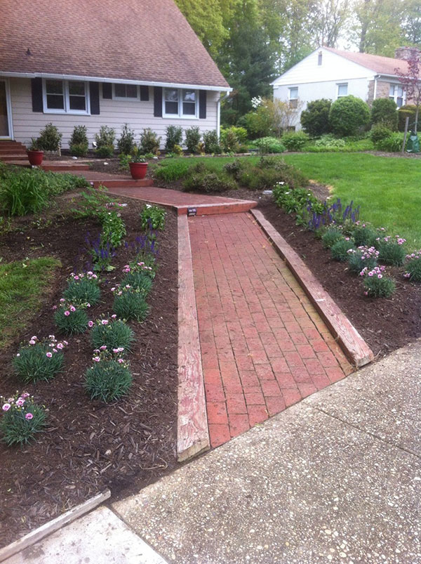 New Plants Installed on Either Side of Front Walkway